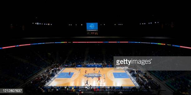 basketball players playing on court - nba stock pictures, royalty-free photos & images