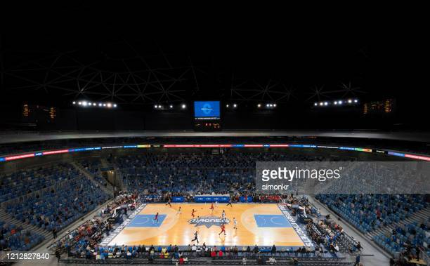basketball players playing on court - stadium stock pictures, royalty-free photos & images