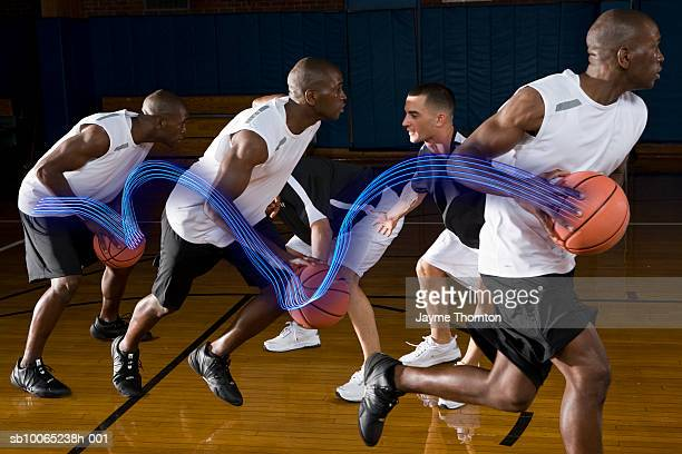 Basketball players playing on court (Digital Composite)