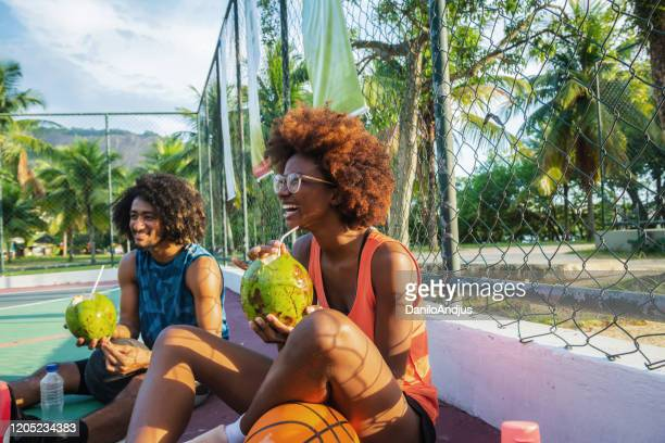 basketball players relaxing at sports court - coconut water stock pictures, royalty-free photos & images