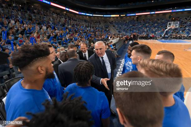 basketball players shaking hands with coach - sports round stock pictures, royalty-free photos & images