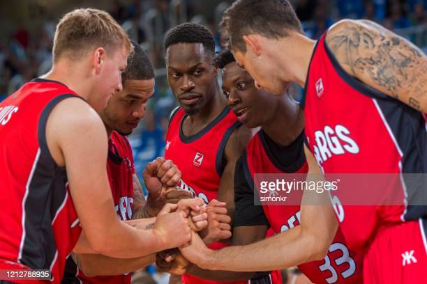 basketball players stacking hands - nba stock pictures, royalty-free photos & images