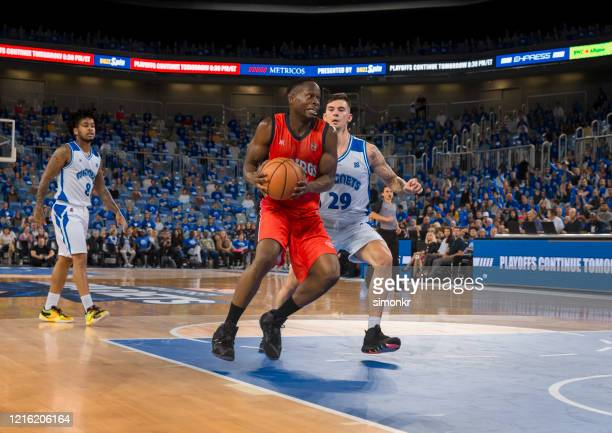 basketball players tackling for ball - nba stock pictures, royalty-free photos & images
