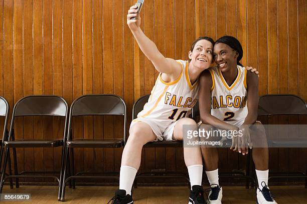Basketball players taking a picture