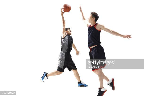 basketball players to play basketball - デイフェンス ストックフォトと画像