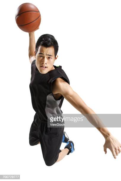 basketball players to play basketball - ダンクシュート ストックフォトと画像