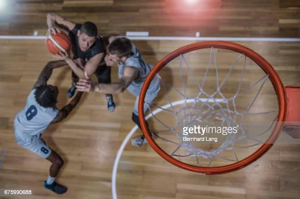 Basketball Players under basket