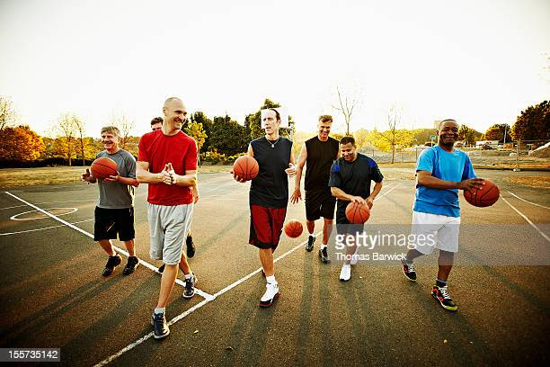 Basketball players walking off court together