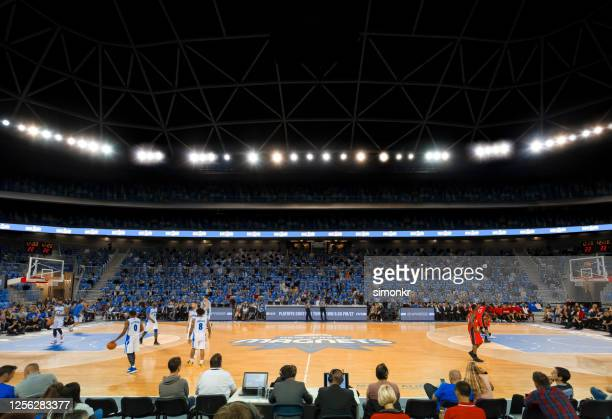basketball players warming up on court - commentator stock pictures, royalty-free photos & images