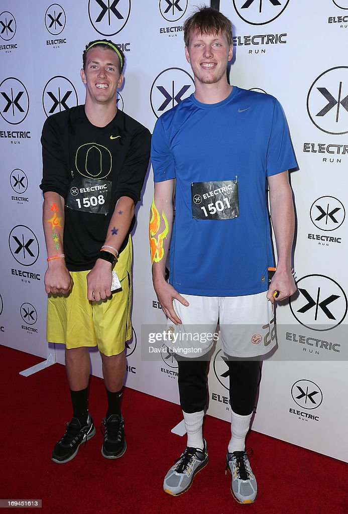 Basketball players/brothers E.J. Singler (L) and Kyle Singler attend Electric Run LA at The Home Depot Center on May 24, 2013 in Carson, California.