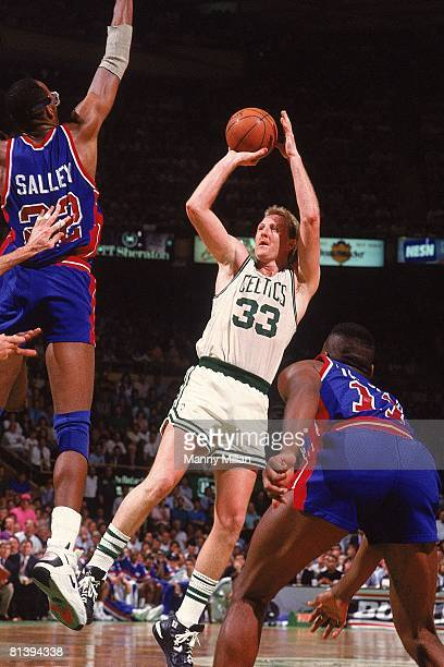 Basketball playoffs Boston Celtics Larry Bird in action taking shot vs Detroit Pistons John Salley Boston MA 5/15/1991