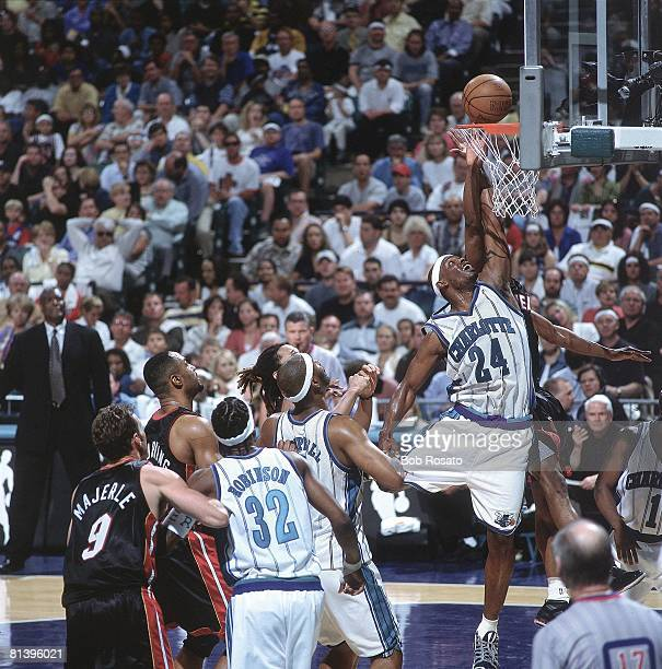 Basketball playoffs Charlotte Hornets Jamal Mashburn in action vs Miami Heat's Eddie Jones Charlotte NC 4/27/2001