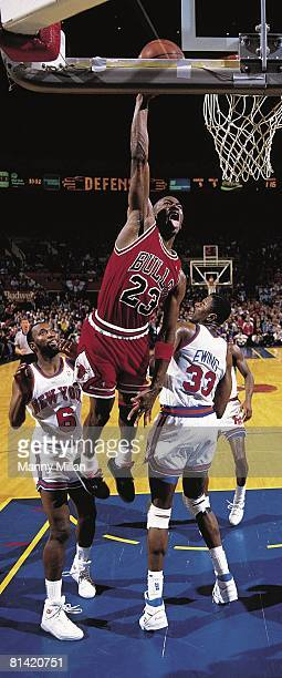 Basketball playoffs Chicago Bulls Michael Jordan in action making dunk vs New York Knicks Patrick Ewing and Trent Tucker New York NY 5/16/1989