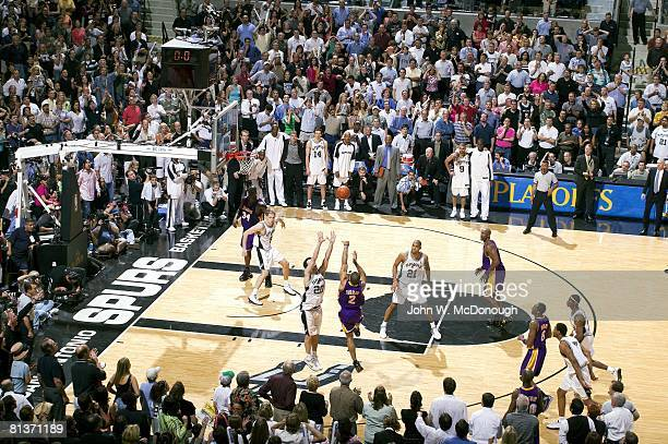 Basketball playoffs Los Angeles Lakers Derek Fisher in action scoring game winning shot vs San Antonio Spurs Manu Ginobili San Antonio TX 5/13/2004
