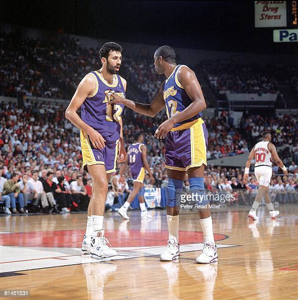 Basketball playoffs Los Angeles Lakers Earvin Magic Johnson with Vlade Divac during game vs Portland Trail Blazers Portland OR 5/18/1991