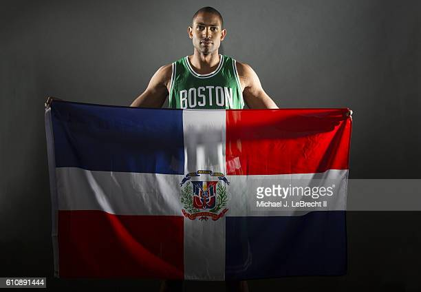 Portrait of Boston Celtics Al Horford posing with the national flag of Dominican Republic during photo shoot at The Sports Authority Training Center...