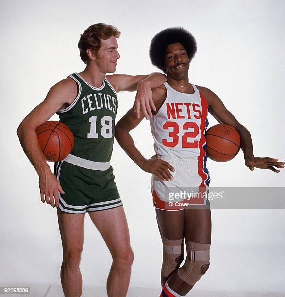 Portrait of Boston Celtics Dave Cowen and New York Nets Julius Dr J Erving with ball 9/20/1976 CREDIT Irving Penn