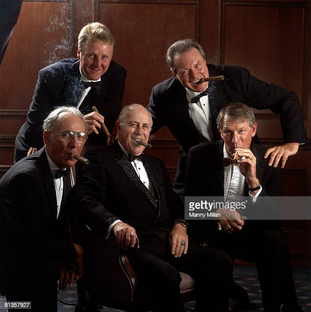 Basketball Portrait of Boston Celtics owner Red Auerbach smoking cigar with Tommy Heinson Larry Byrd John Havlicek and Bob Cousy on his 75th birthday...