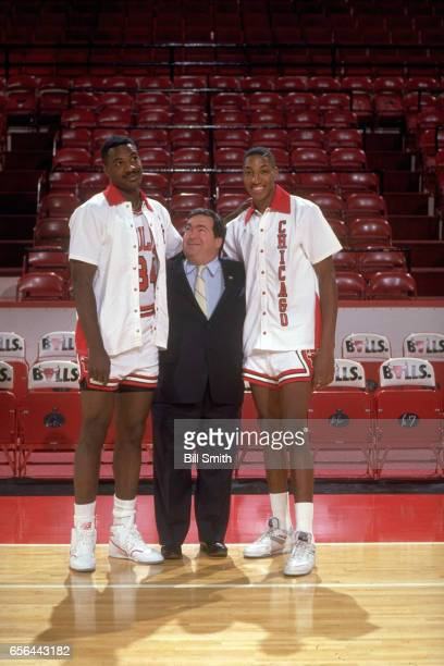 Portrait of Chicago Bulls Charles Oakley General Manager Jerry Krause and Scottie Pippen posing on court at the United Center Chicago IL CREDIT Bill...