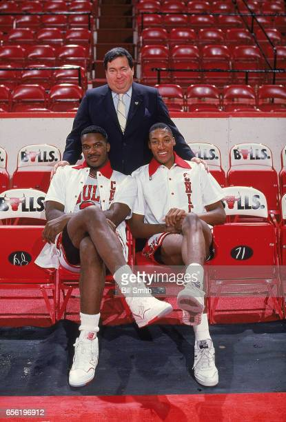 Portrait of Chicago Bulls General Manager Jerry Krause with Charles Oakley and Scottie Pippen posing on court at the United Center Chicago IL...