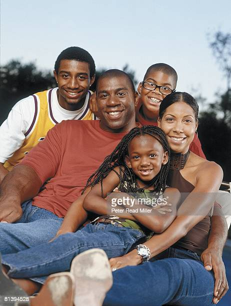 Basketball Portrait of former Los Angeles Laker Earvin Magic Johnson with family Andre EJ Cookie and Alyssa Los Angeles CA 7/14/2001