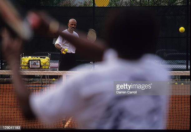 Portrait of former NBA player and coach John Lucas coaching Lori McNeil during tennis practice Houston TX CREDIT Darren Carroll