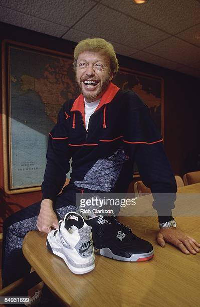 Portrait of Nike Inc cofounder and president Phil Knight holding Air Jordan sneaker Beaverton OR CREDIT Rich Clarkson