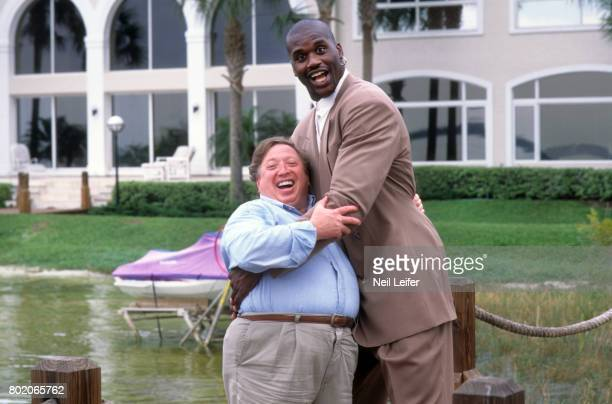 Portrait of Orlando Magic center Shaquille O'Neal with photographer Neil Leifer casual during photo shoot outside his home in Isleworth. Windermere,...