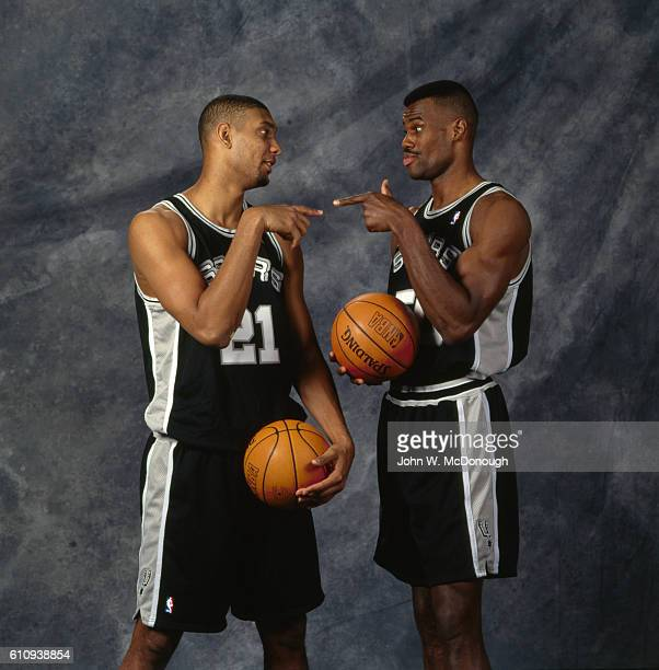 Portrait of San Antonio Spurs Tim Duncan and David Robinson pointing at each other during photo shoot San Antonio TX CREDIT John W McDonough