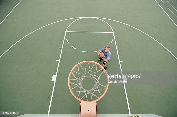Portrait of SI Writer Michael McKnight practicing dunk technique during photo shoot Sequence McKnight a 42 year old father of three trained for 363...