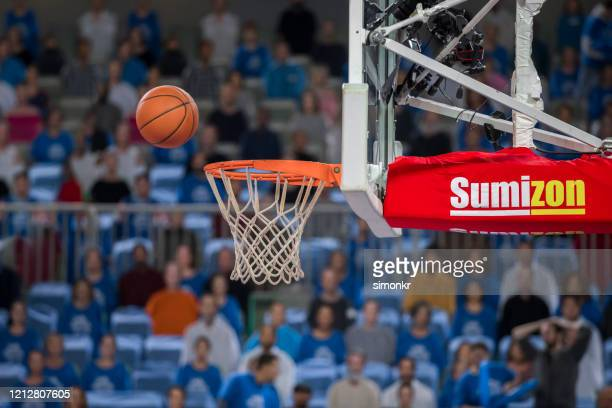 basketball reaching to hoop - nba stock pictures, royalty-free photos & images