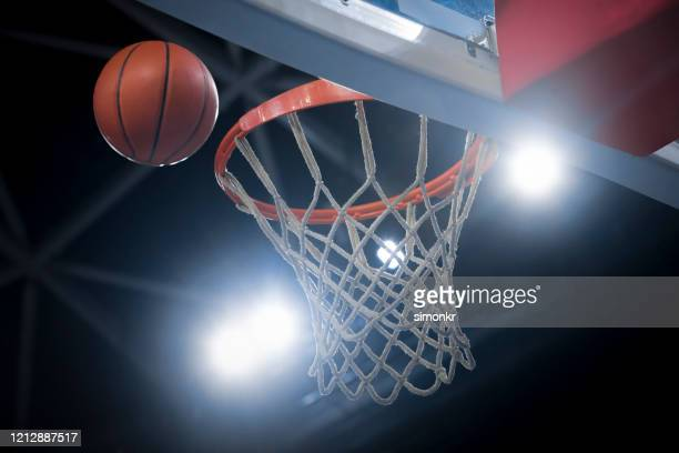 basketball reaching to hoop - basketball hoop stock pictures, royalty-free photos & images