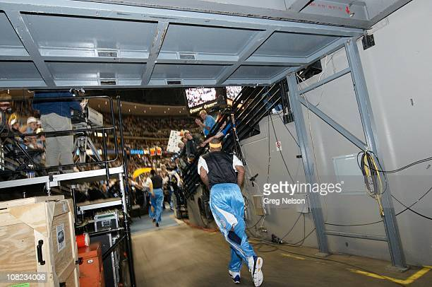 Rear view of Denver Nuggets Carmelo Anthony running out of tunnel during player introductions before game vs Miami Heat at Pepsi CenterDenver CO...