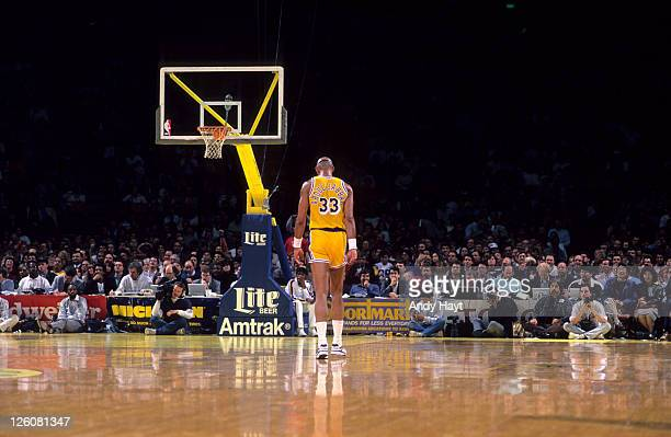 Rear view of Los Angeles Lakers Kareem AbdulJabbar walking on court during game vs Sacramento Kings at Great Western Forum Inglewood CA CREDIT Andy...