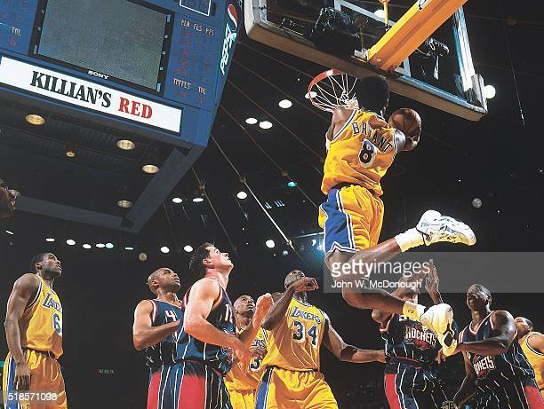 Rear view of Los Angeles Lakers Kobe Bryant in action dunk vs Houston Rockets at The Forum Inglewood CA CREDIT John W McDonough