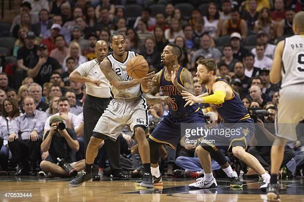 San Antonio Spurs Kawhi Leonard in action passing vs Cleveland Cavaliers JR Smith at ATT Center San Antonio TX CREDIT Greg Nelson