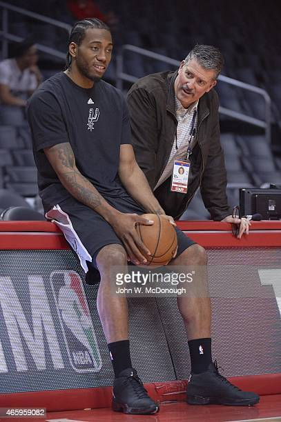 San Antonio Spurs Kawhi Leonard with Los Angeles Clippers public address announcer Eric Smith before game at Staples Center Los Angeles CA CREDIT...