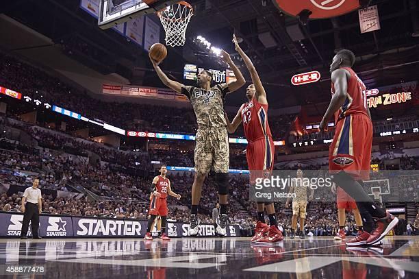 San Antonio Spurs Tim Duncan in action vs New Orleans Pelicans Alexis Ajinca at AT&T Center. San Antonio, TX 11/8/2014 CREDIT: Greg Nelson