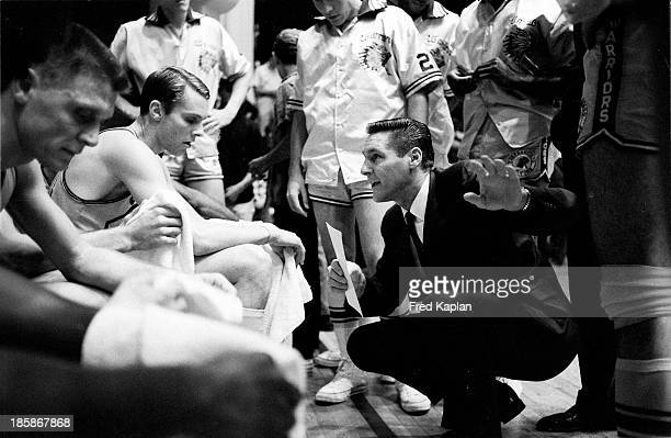 San Francisco Warriors coach Bill Sharman in huddle with players on sidelines during game vs Chicago Bulls at San Jose Civic Auditorium San Jose CA...