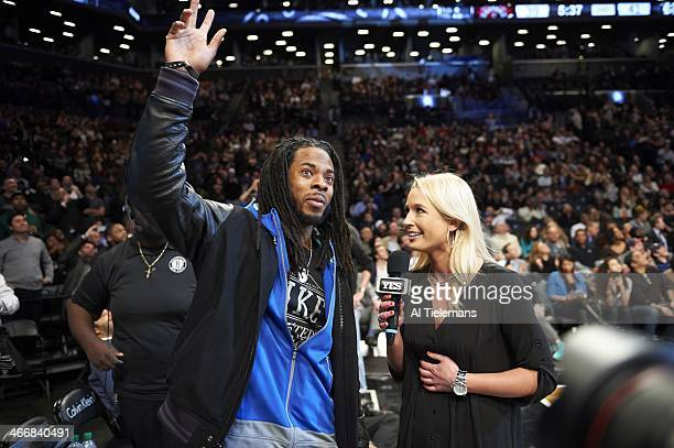 Seattle Seahawks player Richard Sherman during interview with Yes Network reporter Sarah Kustok during Brooklyn Nets vs Toronto Raptors at Barclays...