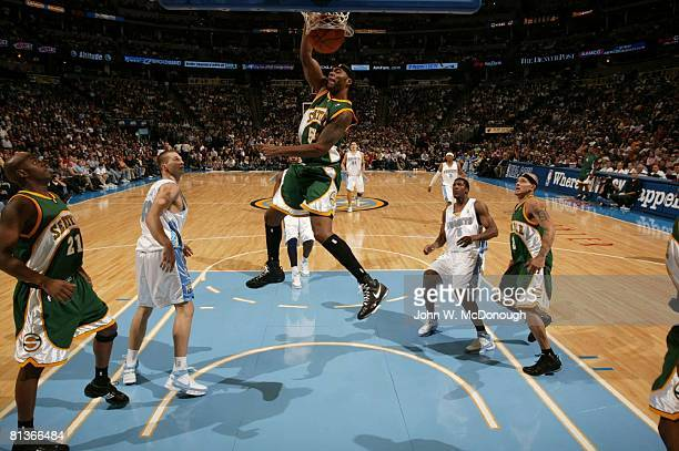 Basketball Seattle SuperSonics Chris Wilcox in action making dunk vs Denver Nuggets Denver CO