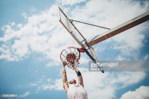basketball shooting - slam dunk stock pictures, royalty-free photos & images