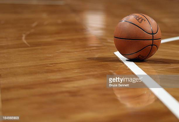 A basketball sits on the court during a break in the action between the Brooklyn Nets and the Philadelphia 76ers during preseason action at the...