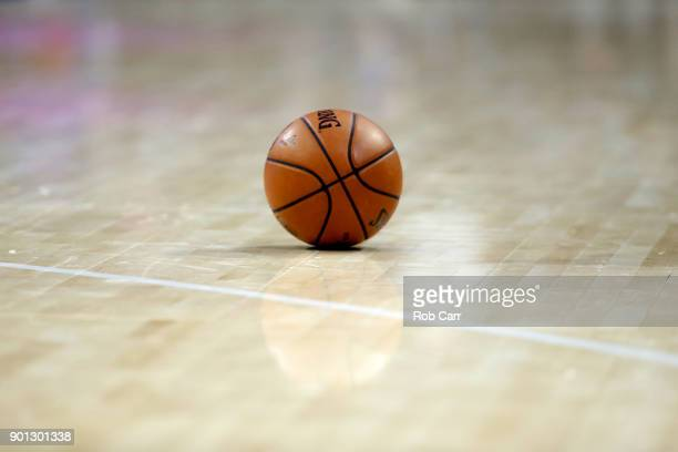 A basketball sits on the floor during a timeout in the Philadelphia 76ers and San Antonio Spurs game at Wells Fargo Center on January 3 2018 in...