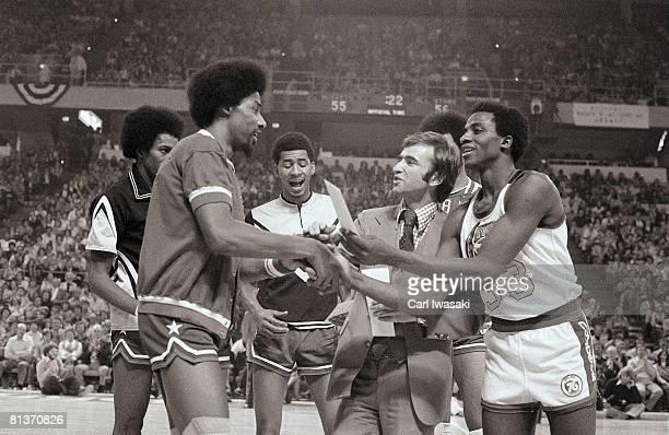 Slam Dunk Contest New York Nets Dr J Julius Erving shaking hands with Denver Nuggets David Thompson on court before contest Denver CO 1/27/1976