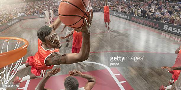 basketball slam dunk - shooting baskets stock photos and pictures