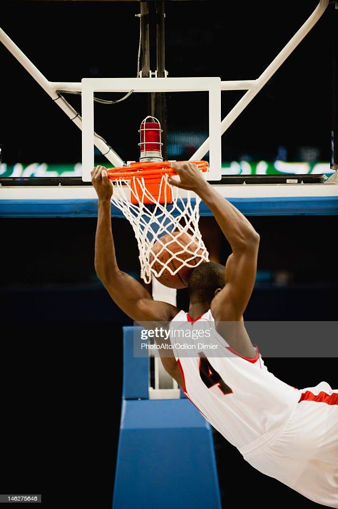 Basketball slam dunking, rear view : Stock Photo