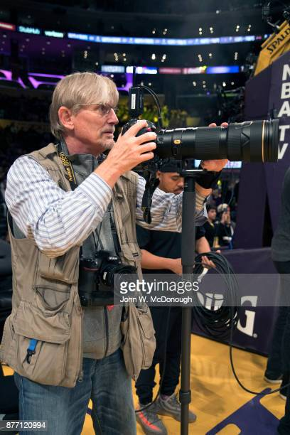 Sports Illustrated photographer John W McDonough holding camera before Los Angeles Lakers vs Philadelphia 76ers game at Staples Center Los Angeles CA...