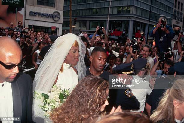 Basketball star and actor Dennis Rodman dressed as a bride arrives in Rockefeller Center with his beautiful young groomswomen