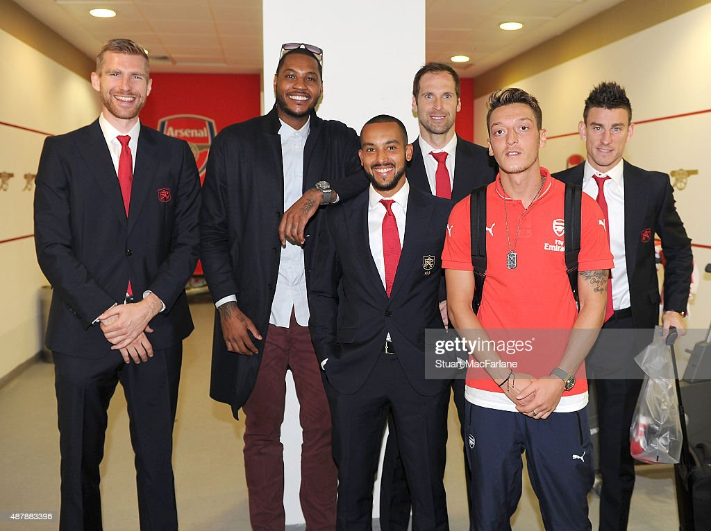 NBA Basketball star Carmelo Anthony with Arsenal players (L) Per Mertesacker (3rdL) Theo Walcott (3rdR) Petr Cech (2ndR) Mesut Ozil and (R) Laurent Koscielny after the Barclays Premier League match between Arsenal and Stoke City on September 12, 2015 in London, United Kingdom.